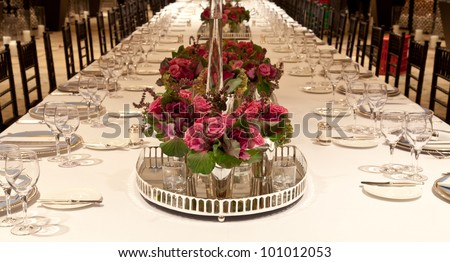 Elegant candlelight  dinner table setting at reception - stock photo