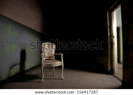 Elegant chair in grunge environment - stock photo
