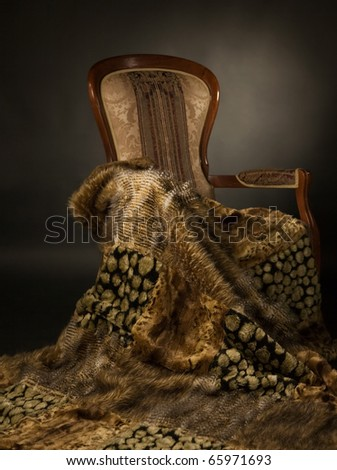 Elegant chair with a fur blanket - stock photo