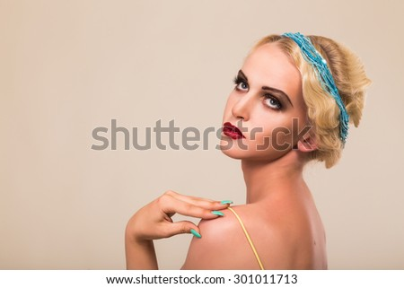 Elegant, charming blonde in a yellow dress. Beautiful make-up in retro style. The concept of beauty fashion - stock photo