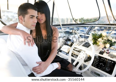 elegant couple in a yacht - stock photo