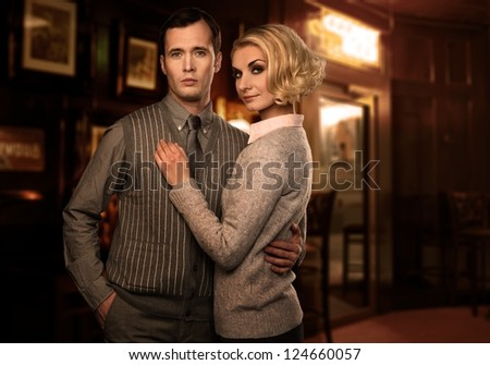 Elegant couple in casual wear indoors - stock photo