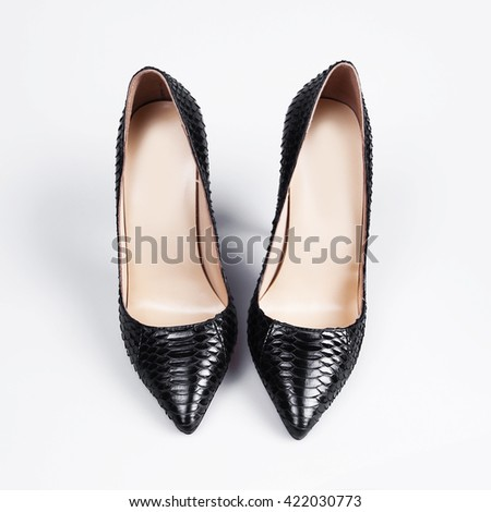 Elegant expensive black high heel women shoes on white background - stock photo