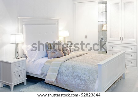Elegant fancy white bedroom with double bed - stock photo
