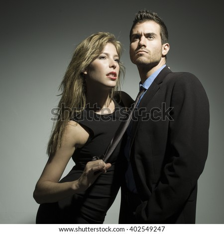 elegant fashionable couple in black suit and dress - stock photo