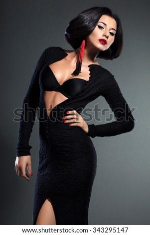elegant fashionable woman in black dress - stock photo