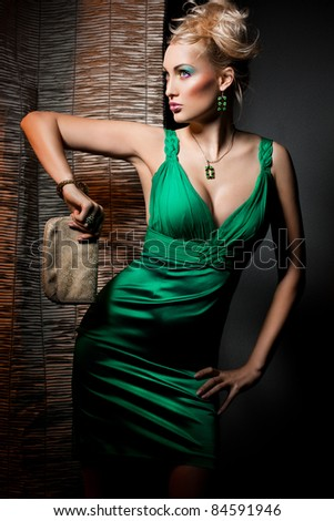 elegant fashionable woman in green dress - stock photo