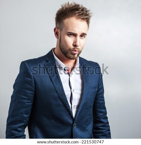 Elegant & friendly young handsome man in costume. Studio fashion portrait.  - stock photo
