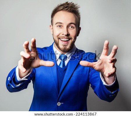 Elegant & friendly young handsome man in costume. Studio fashion portrait. - stock photo
