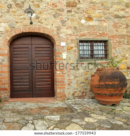 elegant front door  to the tuscan house, Italy - stock photo