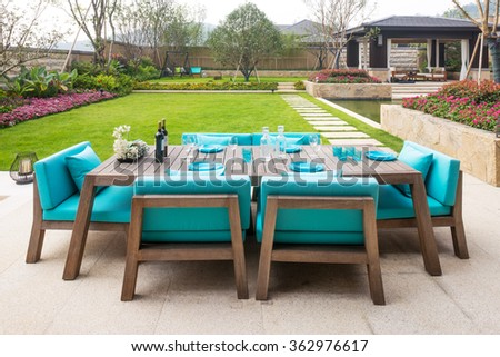 elegant furniture in the patio outside building - stock photo