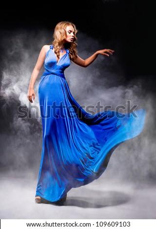 Elegant girl in fluttering blue dress - stock photo