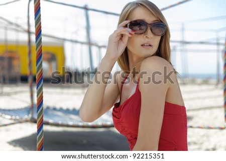 elegant girl posing on the beach - stock photo