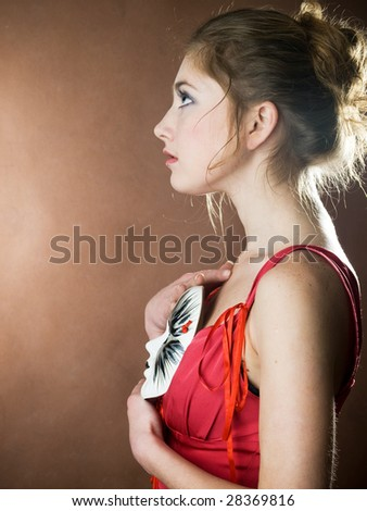 elegant girl with a mask like playing a role in theater - stock photo