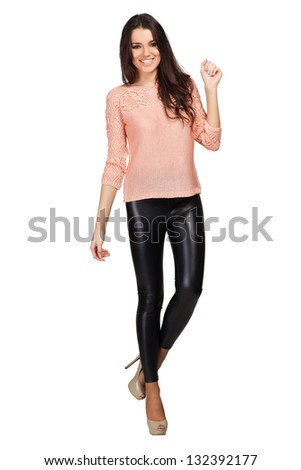 Elegant glamour woman wearing pink blouse and leggins - stock photo