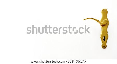 elegant golden door handle of a white door - stock photo