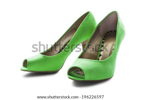 Elegant green textile high heeled shoes isolated over white - stock photo