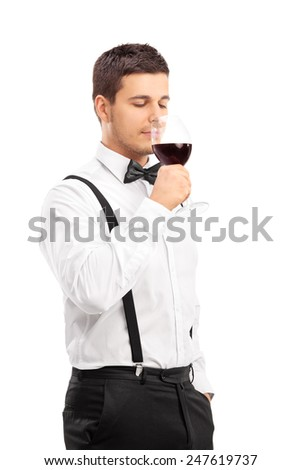 Elegant guy drinking red wine isolated on white background - stock photo