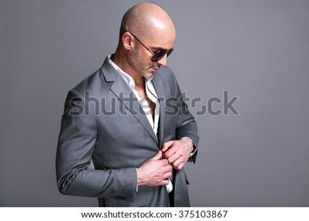 Elegant handsome man wearing glasses. Studio fashion portrait. - stock photo