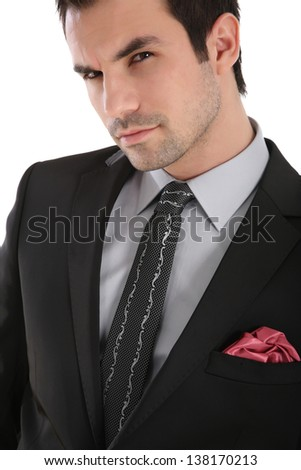 Elegant handsome man with a tie and red pocket handkerchief - stock photo