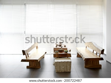 Elegant house interiors,Tea tables and chairs in bright environments blinds - stock photo