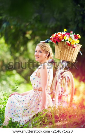 elegant lady relaxing after bicycle ride - stock photo