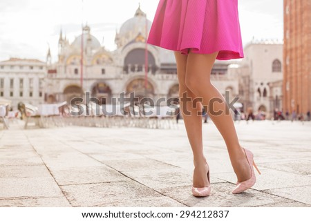 Elegant lady with beautiful legs in high heel shoes - stock photo