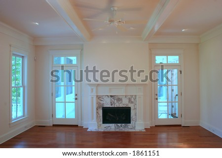 Elegant living room with marble fireplace - stock photo