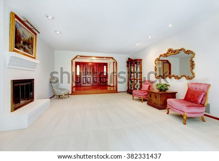Elegant living room with red and white color scheme. - stock photo