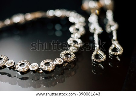 Elegant luxury bridal jewelries on dark background. Wedding details - stock photo