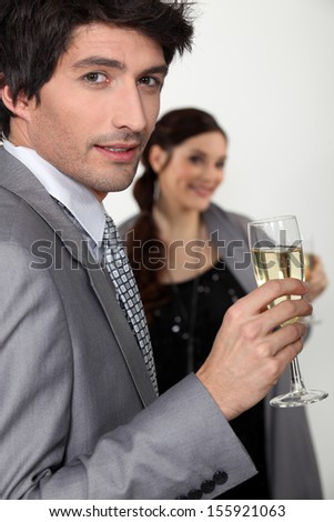 Elegant man drinking champagne - stock photo