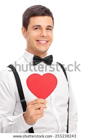 Elegant man holding a heart shaped cardboard isolated on white background - stock photo
