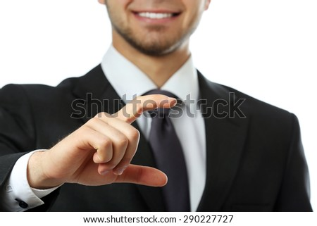 Elegant man in suit holding business card close up - stock photo