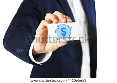 Elegant man in suit holding business card with picture of piggy bank , isolated on white - stock photo
