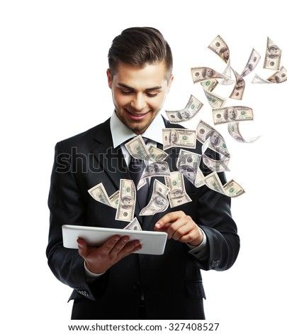 Elegant man in suit holding tablet with money fly out of it - stock photo