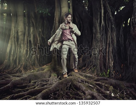 Elegant man on nature background - stock photo