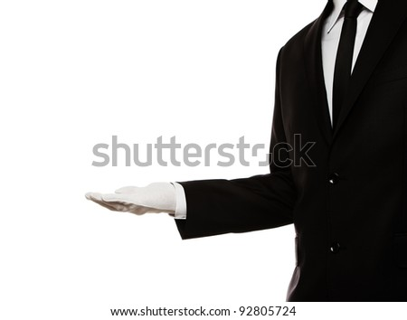 Elegant man presenting something or waiting for a tip - stock photo