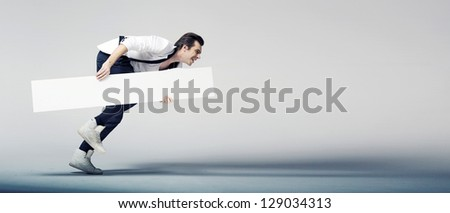 Elegant man running with a white board - stock photo