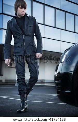 Elegant man walking - stock photo