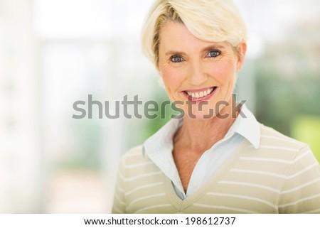 elegant middle aged woman closeup portrait - stock photo