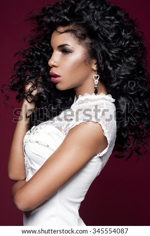 Elegant mulatto girl with long hair - stock photo