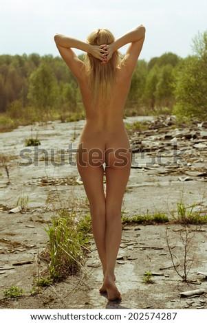 Elegant nude woman posing outdoor - stock photo