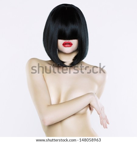 Elegant nude woman with short stylish hairstyle - stock photo