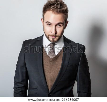 Elegant & Positive young handsome man in costume. Studio fashion portrait.  - stock photo
