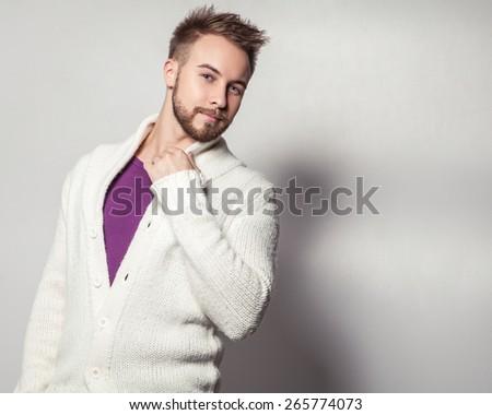 Elegant & positive young handsome man. Studio fashion portrait. - stock photo