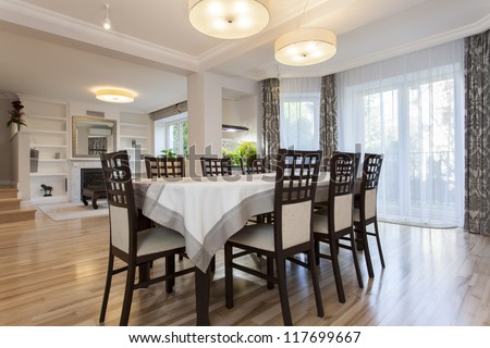 Elegant prepared table in stylish dining room - stock photo
