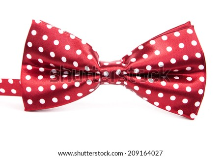 Elegant red bow tie with white polka dots on an isolated white background - stock photo