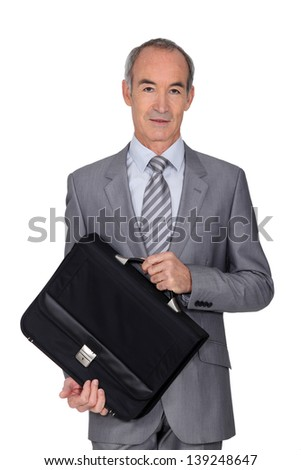 Elegant senior man on white background - stock photo