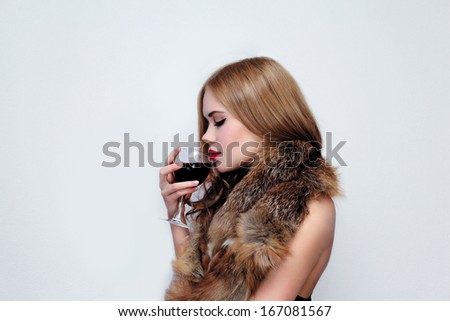 Elegant sensual girl with glass of wine - stock photo
