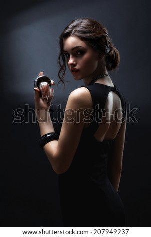 Elegant sensual young woman holding perfume, Beautiful woman face. Perfect makeup. Beauty fashion. Fashion photo - stock photo